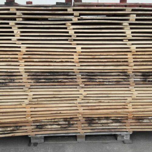 Gestapelde deksels voor blokpalletten